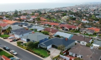 drone of house with ocean in background